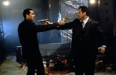 """Face/Off (1997) Nicolas Cage and John Travolta / Quote - Castor Troy: """" Wow. We have something in common. We both know our guns """""""