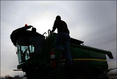 """American farmers confront 'big data' revolution Nick Guetterman climbs into a combine on his farm near Bucyrus, Kan., Wednesday, Feb. 19, 2014.  """"The involvement of the American Farm Bureau, the nation's largest and most prominent farming organization, illustrates how agriculture is cautiously entering a new era in which raw planting data holds both the promise of higher yields and the peril that the information could be hacked or exploited by corporations or government agencies."""""""