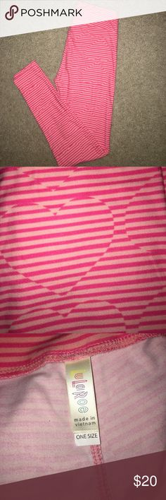 LuLaRoe Valentine's Day Leggings LuLaRoe light pink and hot pink stripe leggings with hearts. These are from the Valentine's Day collection so they do run small. One size (OS) fits 2-12 I would say these fit 00-6. Super soft and comfortable. Never been worn or washed! LuLaRoe Pants Leggings