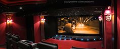 This private cinema room of 36 m2 in Cannes (France) has all the characteristics for a true rendering of a cinema: Two main colors: Red and black 10 black mottled leather seats arranged in staggered form. Scene under the screen in the form of backlit waves. Decorative oval columns and bright arc crystal lights. Walls covered with patented acoustic panels. Acoustic ceiling with starry sky THX Ultra 2 Speaker System. Transparent screen canvas 4K format 2: 35 cinemascope of 360cm base. Latest…