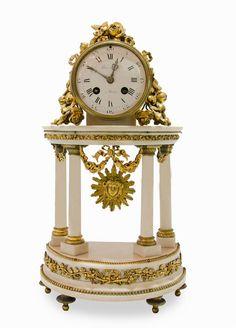 A LOUIS XVI STYLE CLOCK