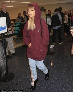 Cover up girl: Ariane Grande was almost unrecognisable in an oversized…