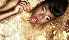 Golden with a classic red lip. I like this orange variation.... my favorite winter make up look.