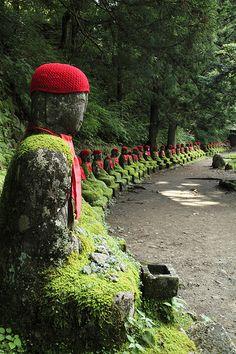 Jizo statues at Nikko in Tochigi Prefecture, Japan. Jizo are guardians of children.