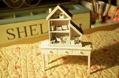 This is getting really cool and scary at the same time.  It is like staring at the slush puppy cup.  You know, the dog holding the cup with a picture of the dog holding a cup, etc...  Dollhouse for a dollhouse!! by Bellafaye, via Flickr