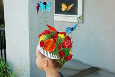 CRAZY HAIR DAY: Click for lots of ideas but this is a rose garden!  It is all contained by a mini picket fence.  She sprayed the hair green and clipped a bunch of flowers into it!