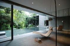 Exterior smoked glass is very cool.  Dancing Trees, Singing Birds / Hiroshi Nakamura