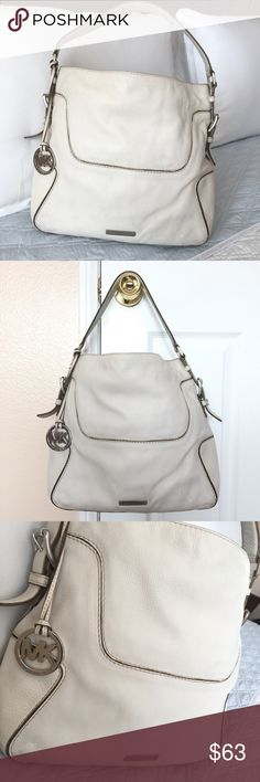 """Authentic Michael Kors Leather Bag Authentic! Beautiful soft leather bag from Michael Kors 💕 Approximate measurements: NOT EXACT 13"""" x  11 1/2"""" x 3 3/4"""" It has interior pockets. In good, used condition (scratches/marks/wear INSIDE & OUTSIDE)  GORGEOUS AND STURDY LEATHER BAG. NO TRADE ❌ Michael Kors Bags"""