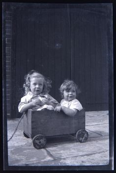 mudwerks:  Squeeeeeze - two kids in a tiny wooden cart, ca 1930 (by whatsthatpicture)