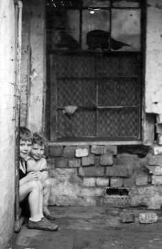 June 1936: This house in Richmond was condemned. It was occupied by a family of eight. The bricks below the window were falling out, leaving a big hole into the kitchen. The house was damp and cold. Picture: Herald Sun Image Library