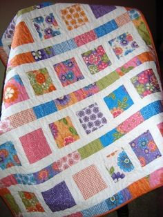 """Finished size is 41.5"""" x 49.5"""".     This quilt pattern is:  2 Charm Packs (71 charm squares)  OR 1 layer cake  OR 12 Fat Quarters  1 yard of neutral (white or cream) for sashing and borders  1.66 yards backing (60 inches)  1/2 yard for binding"""