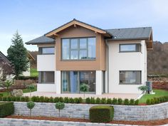 Classic 157S • Architektenhaus von HARTL Haus • Fertighaus mit Zwerchdach und großzügiger Küche • Jetzt bei Musterhaus.net informieren!