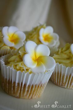 Cocount Cupcakes with fondant flower, perfect for a luau.