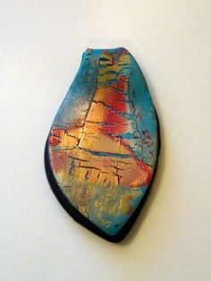 Aqua and gold polymer pendant with black background