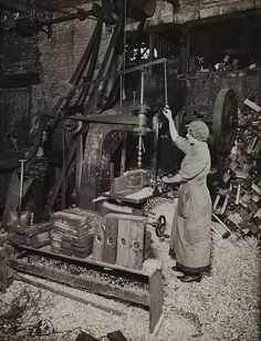 Woman operating boring machine; boring wooden reels for winding barbed wire. Book Title: What the Daughters of Britain are Doing Artist: Tella Camera Co. Creation Date: c. 1917 Process: gelatin silver print Credit Line: Gift of Stephen White Accession Number: 2005.024.030