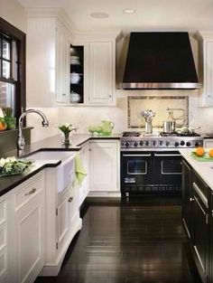 Love the dark floors with the clean white cabinets. Another dream kitchen idea!