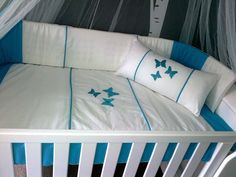Baby cot set - Turquoise & white embroidered with beautiful butterflies. www.facebook.com/borderboutique.co.za