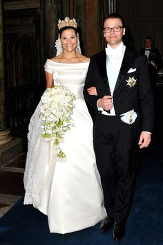 The satin dress of Crown Princess Victoria of Sweden had a lace veil and was complemented by a pretty hanging bouquet of white flowers. The wedding of Victoria, Crown Princess of Sweden and Prince Daniel (born Olof Daniel Westling) took place on 19 June 2010 in Stockholm Cathedral.