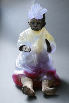 "Made by: Christina Bothwell , ""LIttle Ganesha"" - (the Ganesha is seen through the abdomen), cast glass, raku clay, found objects, oil paints. Made in: 2013"