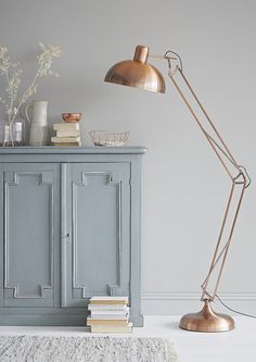 Deliberately muted with a dark grey antiquing effect, this large copper floor lamp would be a welcome addition in a lounge or study room. (Copper Floor Lamp, £159.95, rigby & mac). Find more metallics and copper inspiration at housebeautiful.co.uk