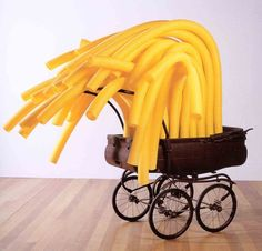 Don Driver.  Yellow Tentacle Pram.  1980. Mixed media. 1700 x 1400 x 1740 mm. Collection of the Dunedin Public Art Gallery.