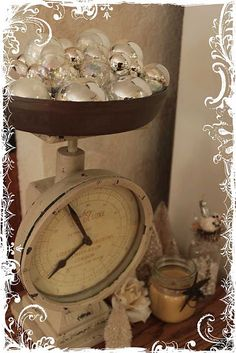 Silver and white balls in vintage style scale clock