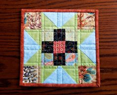 Quilted patchwork insulated pot holder hot pad by StephsQuilts