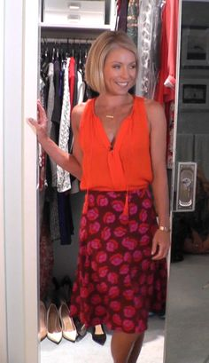 Today Kelly Ripa wore this orange Joie Top and DVF Skirt from Neiman Marcus.