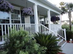 front verandah ideas - hanging baskets over the railing