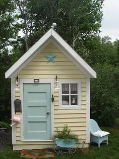 Soft yellow and powder blue garden shed