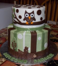 "Forrest Animals - 6"" & 8"" cakes iced in buttercream with hand cut fondant decorations. This cake was made to match the baby shower invitations. TFL!"