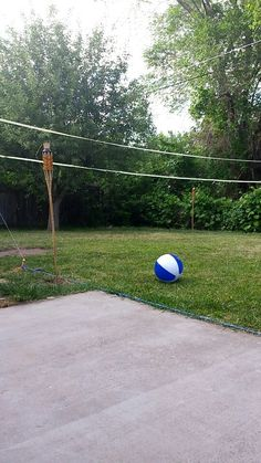 Diy volleyball court! Tiki torches for night games and to fight off bugs! Easy and cheap to do