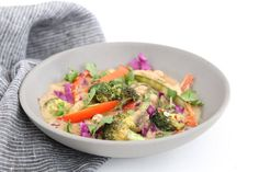 This Thai chicken stir fry is super delicious and ready in just minutes. It's yummy over quinoa or brown rice to soak up the peanut-coconut sauce.