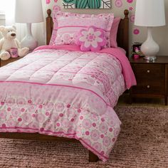 Turn your child's bedroom into a garden with this delightful comforter set and shaped fleece decorative pink flower pillow. This machine washable bedding set is made of brushed polyester, which is comfortable as well as easy care and wrinkle-resistant.