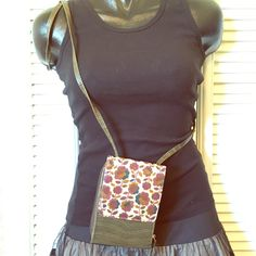 Floral Crossbody Adorable crossbody / brand new / perfect condition / never used / two separate compartments / plenty of storage for cash, coin and keys / includes tiny flashlight that works Bags Crossbody Bags