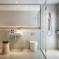 Ultra sleek and contemporary bathroom with ample face level storage behind mirrored doors, open recessed shelf and even hidden storage behind tiles. Love the high end fixtures and clean lines of this bathroom. Bathroom Photos, Budget Bathroom, Bathroom Layout, Bathroom Interior Design, Bathroom Renovations, Bathroom Ideas, Shower Ideas, Bathroom Makeovers, Bathroom Mirrors