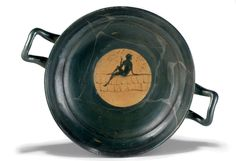 AN ATTIC BLACK-FIGURE KYLIX CIRCA 400 B.C.