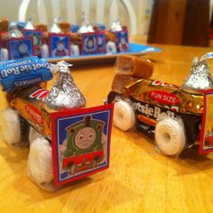 Thomas the Train party favors! Cutest lil' trains! You can get Junior tootsie tolls @ Party City. Hot glued candies together.