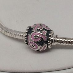 New Pandora Breast Cancer Charm This is a Brand New Authentic Pandora Charm.  Comes in Pandora Pouches or Paper Folding.   All Hallmarked and properly stamped.  If any questions or concerns please drop me a note.   Hard Box Sold Separately $3.00  Thanks and Happy Shopping.   Oh, if you need anything special just let me know and I will do my best to get you what you want. Pandora Jewelry Bracelets