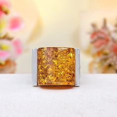 Material: sterling silver Stone(s): a top-grade authentic golden cognac Baltic amber cabochon Ring Face Dimension: 0.65 x 0.85 x 0.4 inch Weight: 13.4 grams Ring Size: 8.5 Stamp / Mark: 925