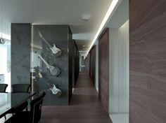 Projekt nowoczesnego holu zakończonego lustrem.  Amfiladowy układ pomieszczeń z muzycznym motywem przewodnim.