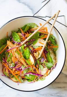 Fresh and healthy Crunchy Apple Slaw made with crisp apples, red cabbage, carrots, fresh basil leaves, and sunflower seeds. This easy apple salad recipe is