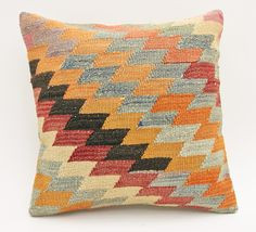 """Turkish Handwoven Wool Kilim Rug Pillow made of unused kilim fragments and pieces unique boho-chic design that will add a touch of inspiration into your environment.FURTHER DETAILS-Front side is made of high quality kilim rug pieces/fragments- Back side is made of a 100% cotton fabric with hidden zipper-Size: 20"""" x 20"""" (50 x 50 CM)-Design and Craftsmanship was done by our well-experienced tailor-Professionally washed and ready to useSHIPPING PROFILEWorldwide Express Shipping via DHL…"""