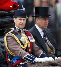 (L) Prince Edward, Earl of Wessex and Prince Andrew, Duke of York travel down The Mall in a horse drawn carriage during 2014 Trooping the Color, Queen Elizabeth II's Birthday Parade in London, England.