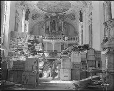 The Nazis stole art. The Monuments Men took it back.April 1945 An American soldier inspects German loot stored in a church at Elligen, Germany. Chef D Oeuvre, Oeuvre D'art, Nara, Monuments, Monument Men, Rare Historical Photos, Harriet Tubman, National Archives, American Soldiers