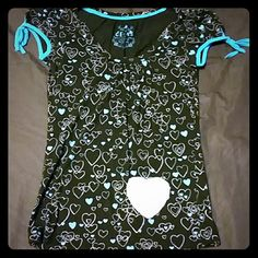 Delia's short-sleeve top Heart print, blue/silver hearts. Fabric/holographic heart on the bottom right corner of top. Sleeves have a bow.  60% Cotton, 40% Rayon. Gently worn. No holes, stains, etc. Delia's Tops