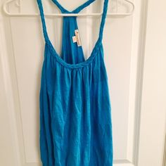 Bright Blue Racerback Size large. Worn a couple times. Braided straps Forever 21 Tops Tank Tops
