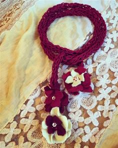 Hand-knit merino cotton felt floral embellished necklace.