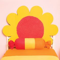 Flower Headboard: What girl doesn't love a makeover? Give her bed a fresh look with this bright headboard made from a science-fair display board [click for how-to]