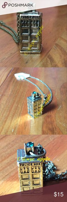"🆕 Gold Tone Doctor Who Tardis Necklace Gold tone 3-D Tardis pendant with gold tone chain. Blue/Green gemstone tops box. Approximately 13"" long. Please ask if you have questions. Whovian. Time Lord. Torchwood. Gallifrey. Cosplay. Science Fiction. Sci-fi. Costume. Police Box. Jewelry Necklaces"